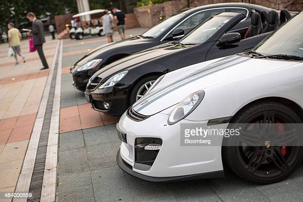 A Porsche SE automobile front stands with other luxury supercars parked at Sentosa Cove near the venue of the Singapore Yacht Show in Singapore on...