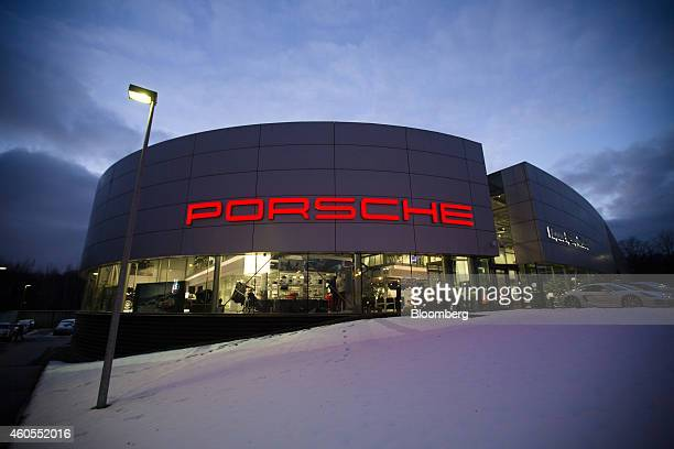 A Porsche sign sits illuminated above a Porsche AG luxury automobile dealership in Moscow Russia on Monday Dec 15 2014 Russia's biggest rate increase...