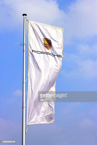 Porsche sports car producer logo on a flag