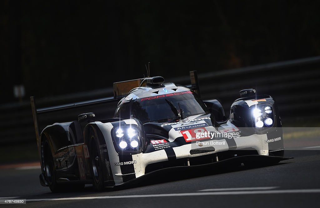 Porsche Team (Germany) driven by <a gi-track='captionPersonalityLinkClicked' href=/galleries/search?phrase=Romain+Dumas&family=editorial&specificpeople=805197 ng-click='$event.stopPropagation()'>Romain Dumas</a>, <a gi-track='captionPersonalityLinkClicked' href=/galleries/search?phrase=Neel+Jani&family=editorial&specificpeople=541892 ng-click='$event.stopPropagation()'>Neel Jani</a> and <a gi-track='captionPersonalityLinkClicked' href=/galleries/search?phrase=Marc+Lieb&family=editorial&specificpeople=3199675 ng-click='$event.stopPropagation()'>Marc Lieb</a> during qualifying for the Le Mans 24 Hour race at the Circuit de la Sarthe on June 11, 2015 in Le Mans, France.