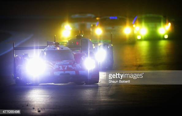 Porsche Team driven by Timo Bernhard Mark Webber and Brendon Hartley during the Le Mans 24 Hour race at the Circuit de la Sarthe on June 13 2015 in...