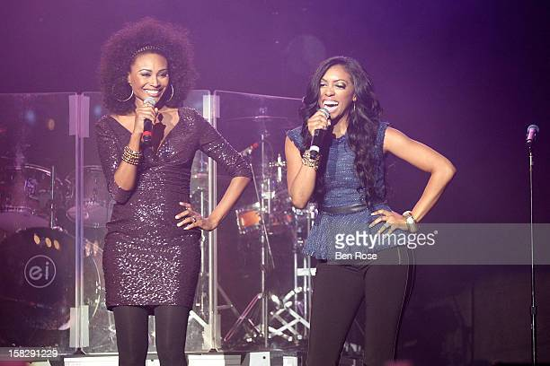 Porsha Stewart and Cynthia Bailey speak onstage during Power 961's Jingle Ball 2012 at the Philips Arena on December 12 2012 in Atlanta