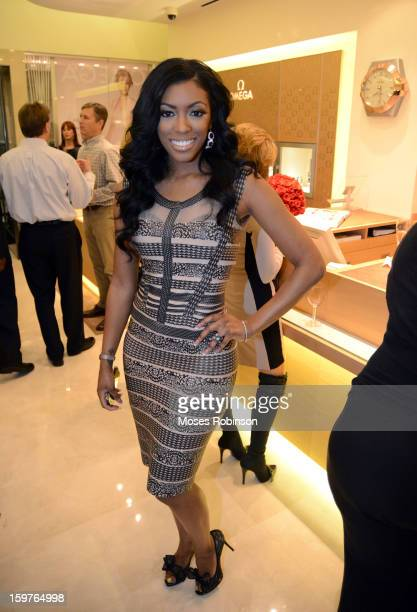 Porsha Stewart attends the OMEGA boutique opening at Phipps Plaza on January 17 2013 in Atlanta Georgia