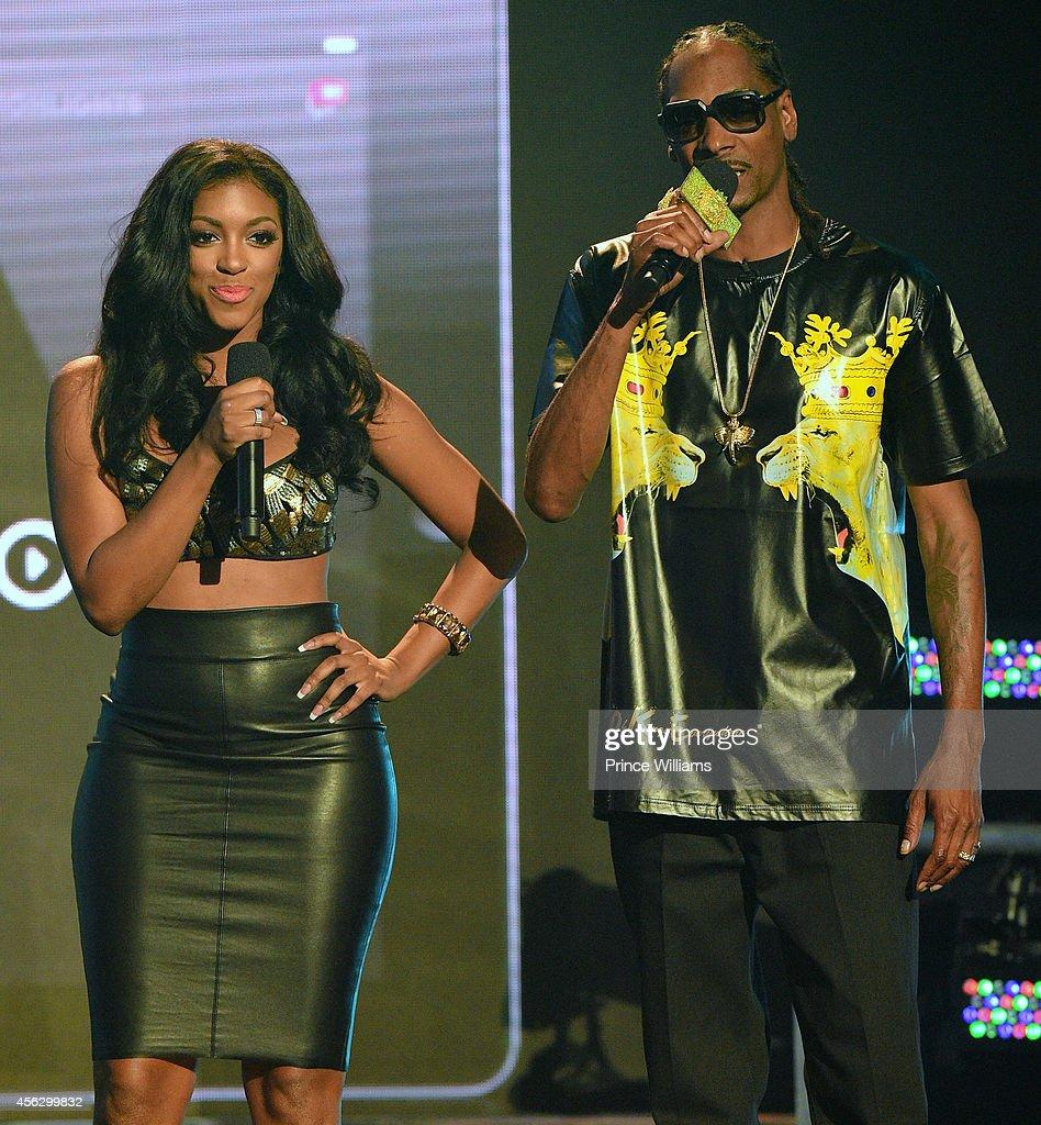Porsha Williams and Snoop Dogg onstage at the BET Hip Hop awards at Boisfeuillet Jones Atlanta Civic Center on September 20, 2014 in Atlanta, Georgia.