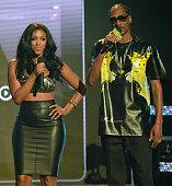 Porsha Williams and Snoop Dogg onstage at the BET Hip Hop awards at Boisfeuillet Jones Atlanta Civic Center on September 20 2014 in Atlanta Georgia