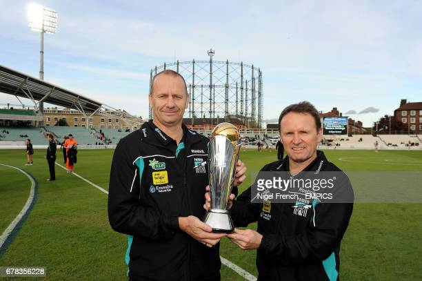 Port Adelaide assistant coach Brad Gotch and senior coach Ken Hinkley with the ICC Trophy
