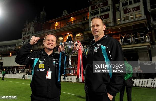 Port Adelaide assistant coach Brad Gotch and senior coach Ken Hinkley with the Challenge Cup after beating Western Bulldogs