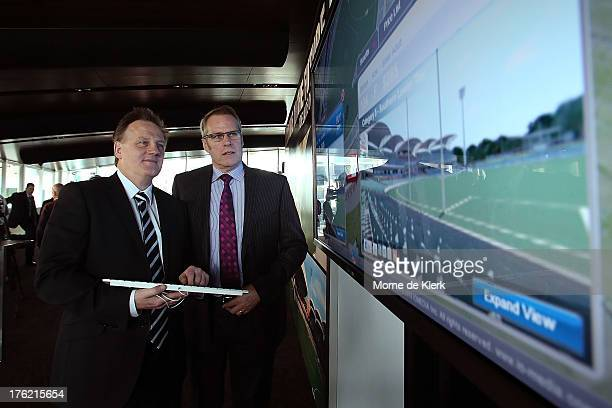 Port Adelaide CEO Keith Thomas and Adelaide Football Club CEO Steven Trigg look at a screen which shows new technology where spectators can now...