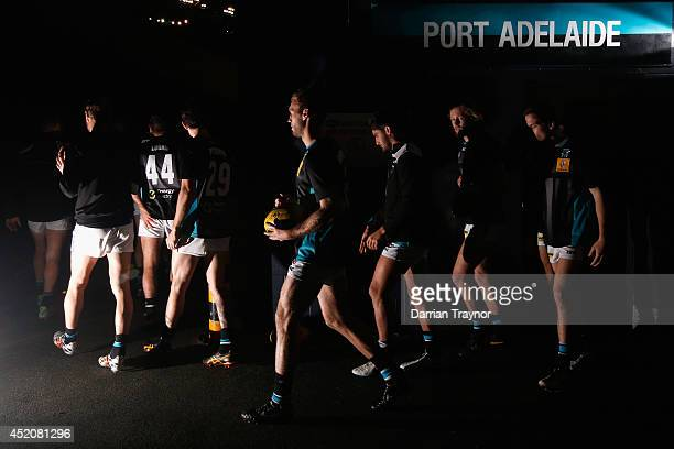 Port Adelaide players walk out for the warm up before during the round 17 AFL match between the Richmond Tigers and the Port Adelaide Power at Etihad...