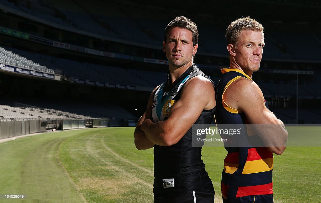 Port Adelaide Power Captain Travis Boak (L) poses with Adelaide Captain Nathan van Berlo during the AFL Captains media Day at Etihad Stadium on March 19, 2013 in Melbourne, Australia.