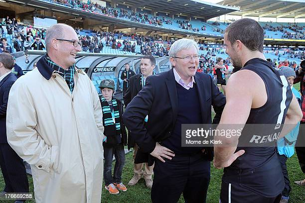 Port Adelaide President David Koch and Prime Minister Kevin Rudd congratulate Travis Boak of the Power after the round 21 AFL match between Port...
