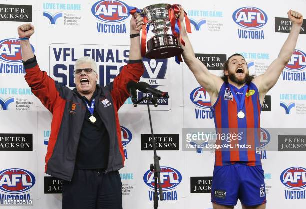 Port coach Gary Ayres and Toby Pinwill of Port Melbourne lift the cup up after winning during the VFL Grand Final match between Richmond and Port...