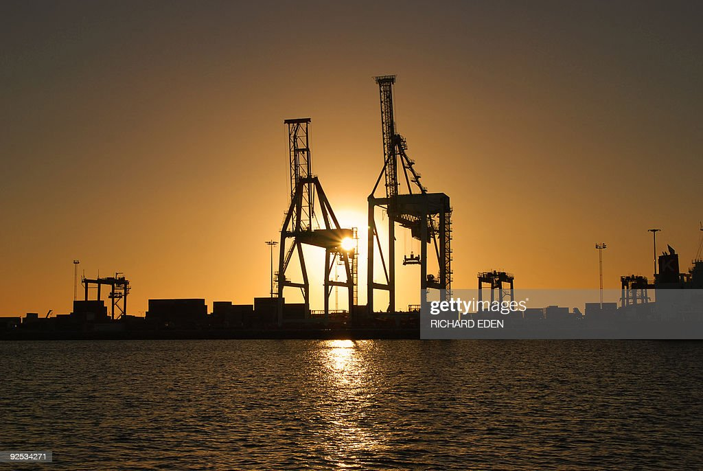 Port Cranes Against Sunset : Stock Photo