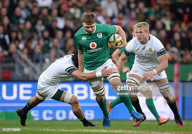 Port Elizabeth South Africa 25 June 2016 Iain Henderson of Ireland is tackled by Warren Whiteley of South Africa during the Castle Lager Incoming...