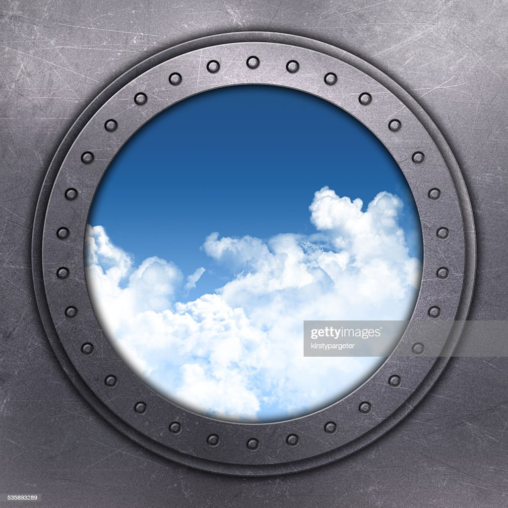 Port Hole looking out onto blue sky : Stock Photo