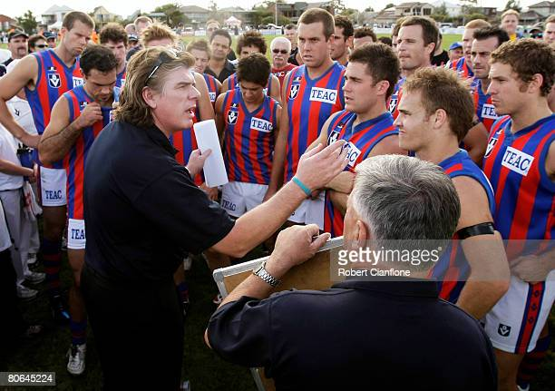 Port Melbourne coach Gary Ayres talks to his players at the break during the round three VFL match between the Williamstown Seagulls and Port...