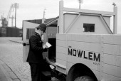Port of London Authority policeman c1945c1965 Constable checking a lorry belonging to John Mowlem and Co Ltd