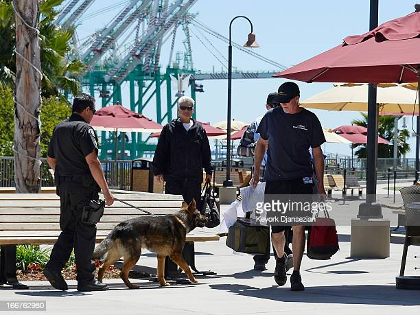 Port of Los Angeles Police officer Anthony Reitz and his bomb sniffing German Sheppard K9 'Boomer' conduct a bomb sweep as crew members of Catalina...