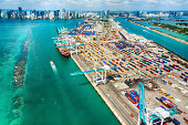 The large seaport of Miami Florida in wide angle on the Biscayne Bay with the skyline of the city in the background.