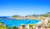 Panoramic view over the harbour and beach of the beautiful Majorcian resort town of Puerto de Soller.