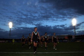 Port players lead by Dean Brogan leave the field after losing the round nine AFL match between the Port Adelaide Power and the Fremantle Dockers at...
