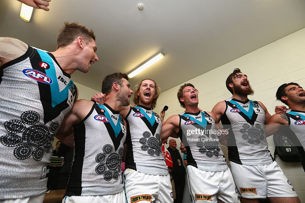 Port Power celebrate after they defeated the Demons during the round 10 AFL match between the Melbourne Demons and the Port Adelaide Power at Traeger Park on May 28, 2016 in Alice Springs, Australia.