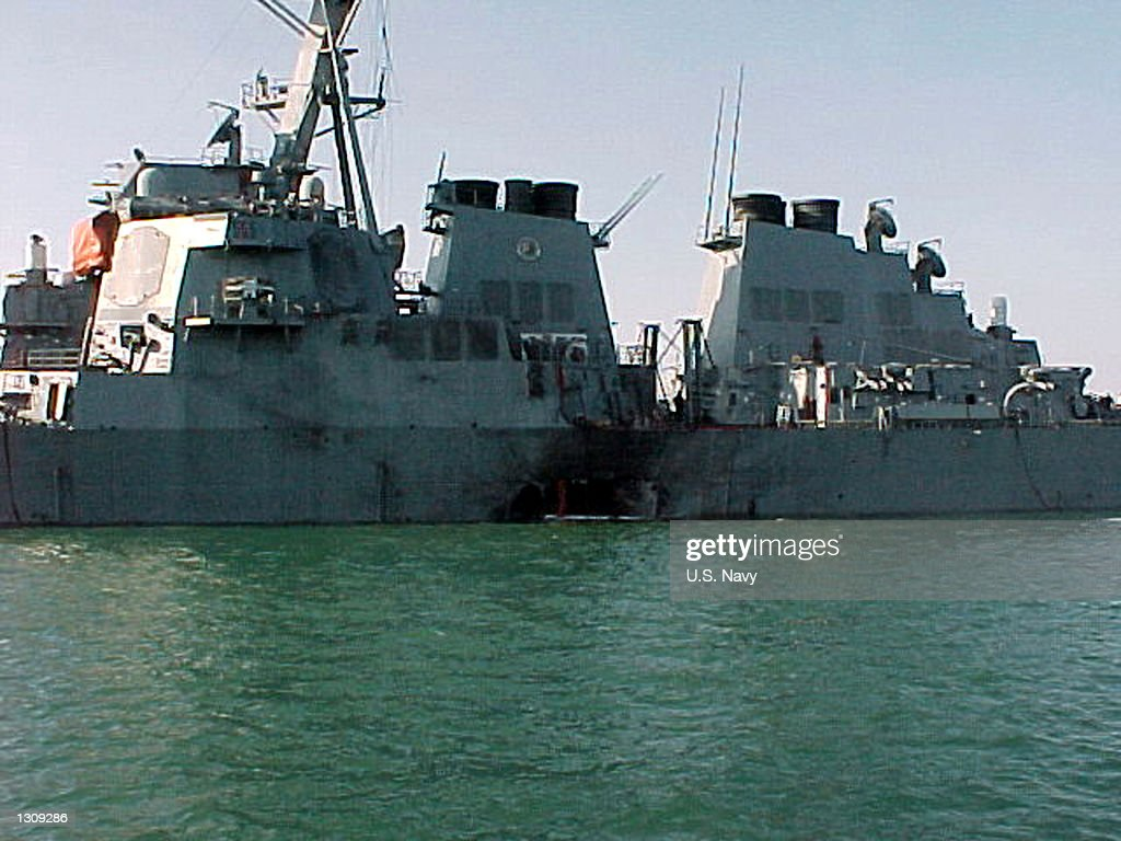 Port side view showing the damage sustained by the Arleigh Burke class guided missile destroyer USS Cole (DDG 67) after a suspected terrorist bomb exploded and killed at least five people and injured 36 during a refueling operation October 12, 2000 in the port of Aden, Yemen. USS Cole is on a regular scheduled six-month deployment.