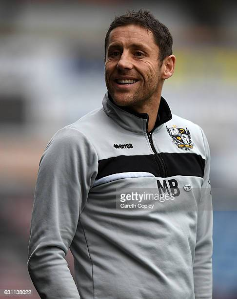 Port Vale caretaker manager Michael Brown during The Emirates FA Cup Third Round match between Huddersfield Town and Port Vale at Galpharm Stadium on...