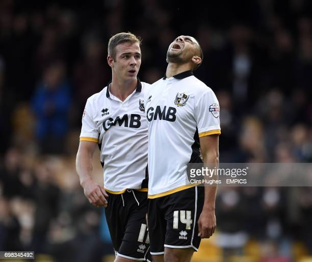 Port Vale's Colin Daniel celebrates with teammate Tom Pope after he scores the fourth goal of the game for his side