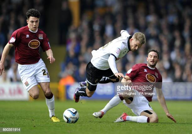 Port Vale's Daniel Jones is tackled by Northampton Town's Chris Hackett during the npower Football League Two match at Vale Park Stoke On Trent