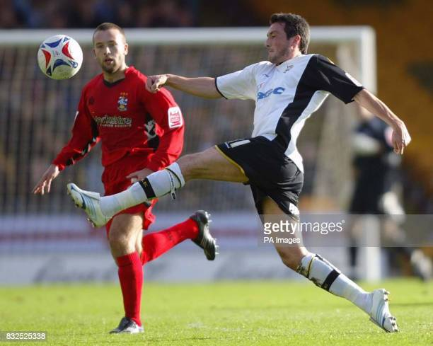 Port Vale's Jeff Smithand Huddersfield's Aaron Hardy battle for the ball during the CocaCola Division One match at Vale Park StokeonTrent