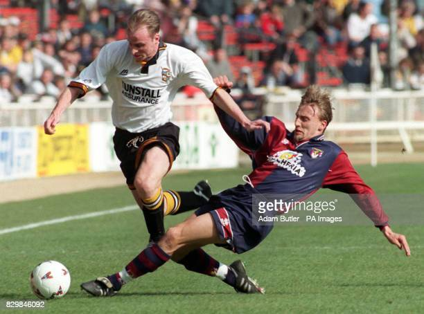 Port Vale's Jon McCarthy is tackled by Genoa's Davide Nicola during the Anglo Italian Cup final at Wembley Stadium