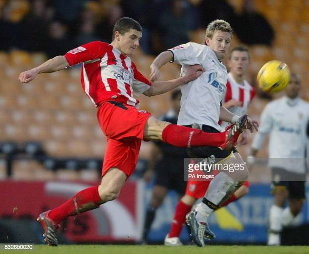 Port Vale's Ross Gardner and Brenford's John Mousinho during the CocaCola League One match at Vale Park StokeonTrent