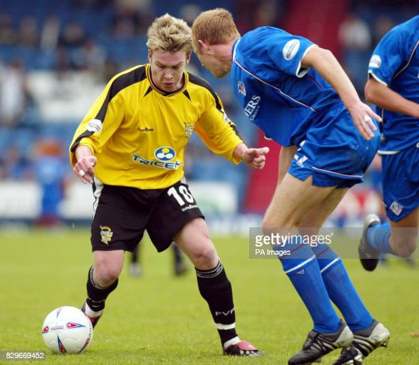 Port Vale's Steve McPhee takes on Oldham's Dean Holden during the Nationwide Division Two match at Boundary Park Oldham THIS PICTURE CAN ONLY BE USED...