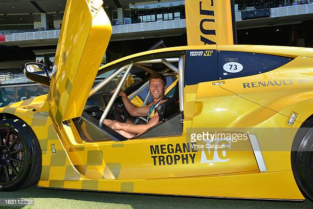 Port vice captain Brad Ebert poses in a Renault car during the announcement of Renault as new sponsor of Port Adelaide during a Port Adelaide...