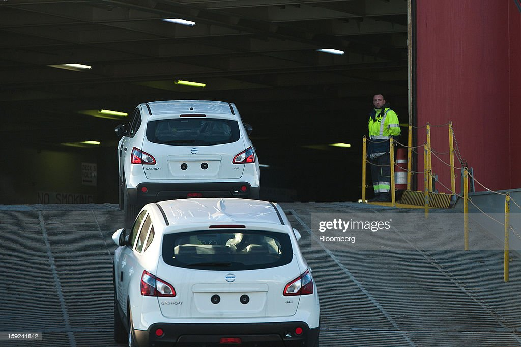 A port worker overseas the loading of new Nissan Motor Co. Qashqai SUV automobiles onto the Le Mans Express roll-on, roll-off (RoRo) ship before shipping from Barcelona port in Barcelona, Spain, on Thursday, Jan. 10, 2013. Spanish exports grew the least in five months in September as the euro area relapsed into a recession and the region's fourth-largest economy continued to contract. Photographer: David Ramos/Bloomberg via Getty Images