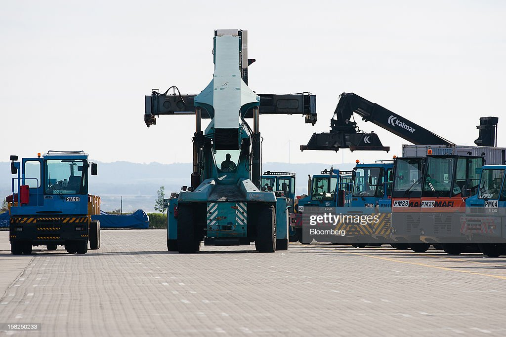 A port worker positions a container crane to move shipping containers on the dockside at the open deep-water Port of Sines in Sines, Portugal, on Tuesday, Dec. 11, 2012. The Portuguese government is ready to implement additional measures in 2013 if there are slippages in meeting budget targets, the European Commission said. Photographer: Mario Proenca/Bloomberg via Getty Images