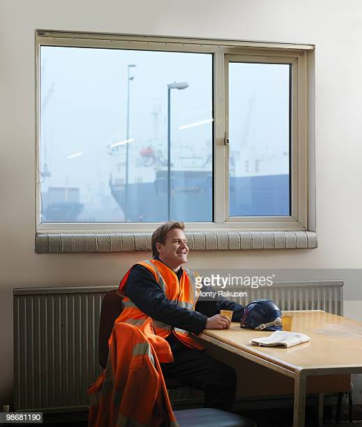 Port Worker Relaxing With Hot Drink