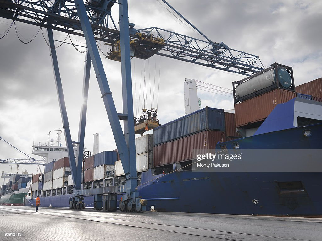 Port Worker Watching Ship Being Loaded