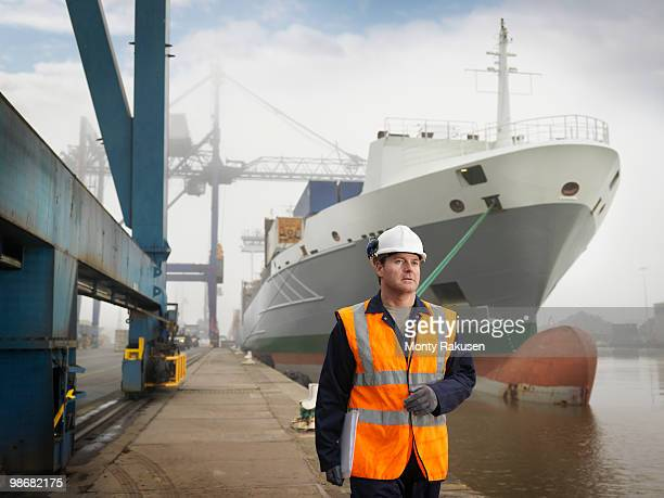 Port Worker With Container Ship