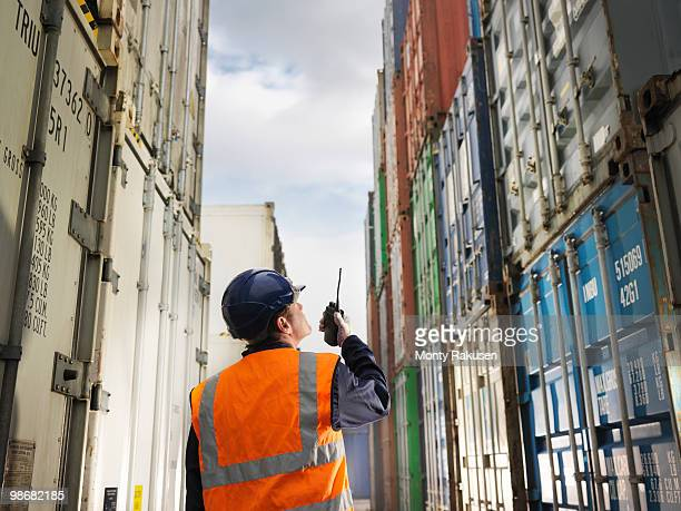 Port Worker With Shipping Containers