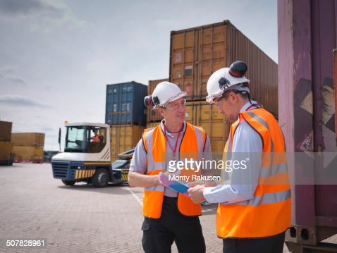 Port workers and shipping containers in port