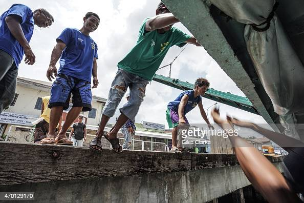 Port workers on the dock of Isabela City tie up the passenger ferry from Zamboanga City March 27 2015