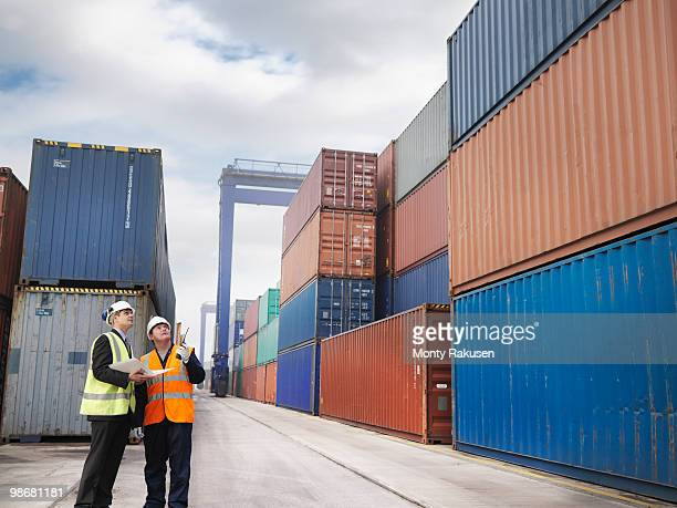 Port Workers With Shipping Containers
