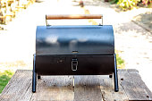 the portable barbecue on the wooden table