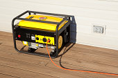 """""""Extension cord plugged into a gasoline powered, 4000 watt, portable electric generator.Please also see;"""""""