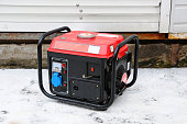 Portable electric generator running in the cold winter.
