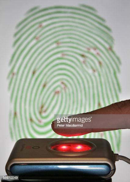 A portable fingerprint scanner is displayed at the Biometrics Conference and Exhibition at the Queen Elizabeth II Conference Centre on October 20...