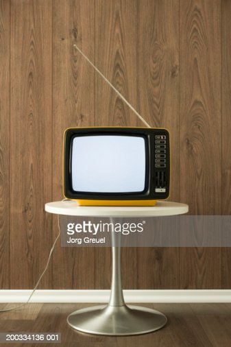 Portable television on table : Stock Photo
