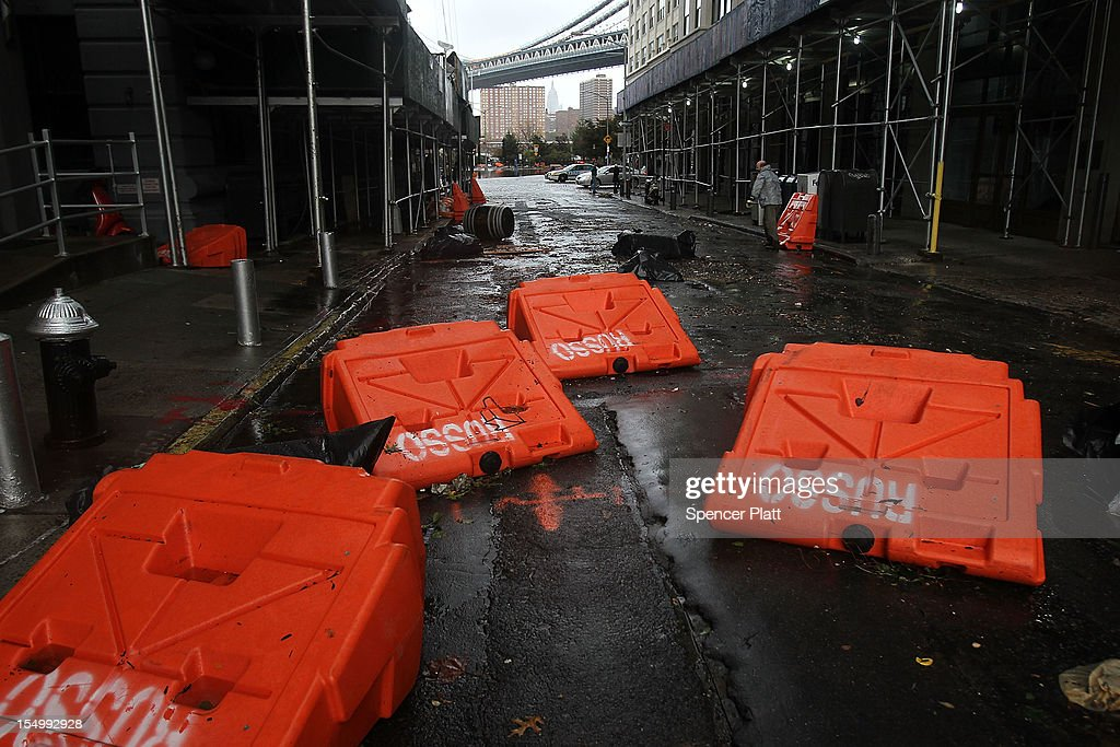 Portable upended flood dikes are viewed on a flooded street in the Dumbo section of Brooklyn after the city awakens to the affects of Hurricane Sandy on October 30, 2012 in New York, United States. At least 33 people were reported killed in the United States by Sandy as millions of people in the eastern United States have awoken to widespread power outages, flooded homes and downed trees. New York City was his especially hard with wide spread power outages and significant flooding in parts of the city.